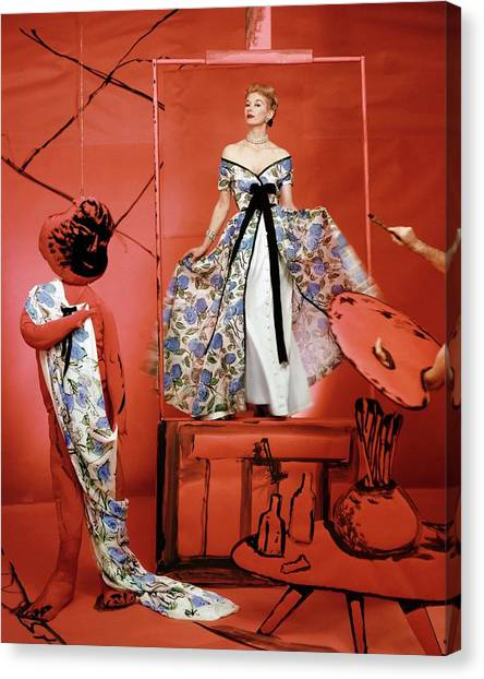 A Portrait Of Lisa Fonnsagrives On A Red Set Canvas Print by Horst P. Horst