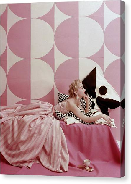 A Portrait Of Lisa Fonssagrives Lying Canvas Print by Richard Rutledge