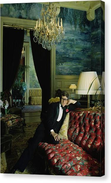 A Portrait Of Yves Saint Laurent At His Home Canvas Print