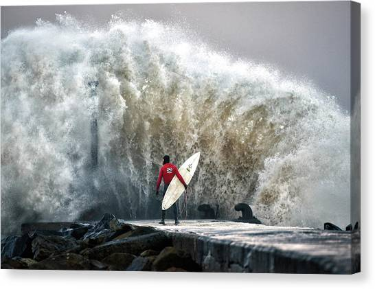 A Pro-surfer Waits For A Break In The Canvas Print by Charles Mcquillan