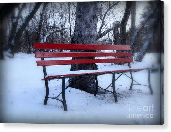 A Red Bench Waiting For Spring Canvas Print