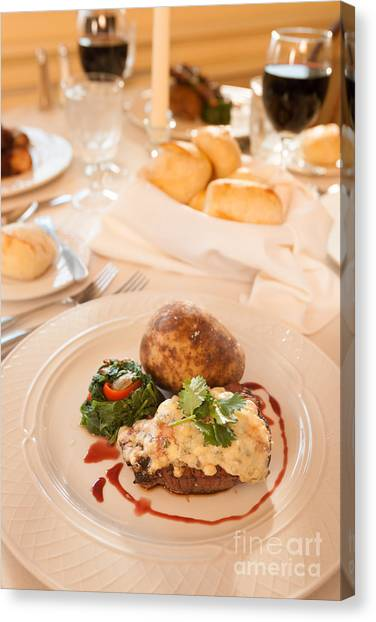 Ribeye Canvas Print - A Restaurant Dinner Of Steak And Baked Potato With Bread And Red by Don Landwehrle
