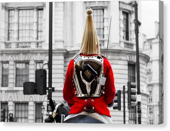 Royal Guard Canvas Print - A Royal Horse Guards Soldier Horse Guards Parade In London England by Michal Bednarek