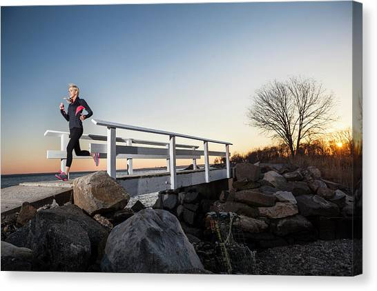 Running Backs Canvas Print - A Runner Crosses A Seaside Bridge by Colin Keaveney