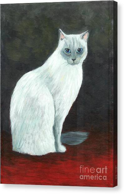 A Siamese Cat On Red Mat Canvas Print