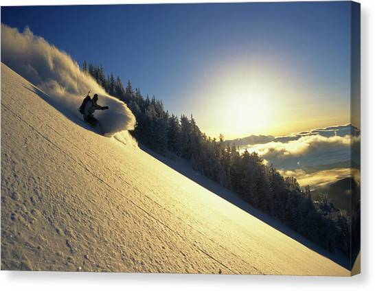Teton National Forest Canvas Print - A Snowboarder Carves A Turn In Fresh by Jeff Diener