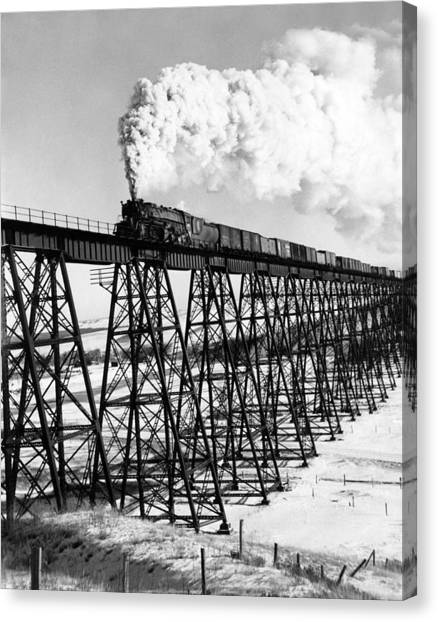 Freight Trains Canvas Print - A Steam Engine On Trestle by Underwood Archives