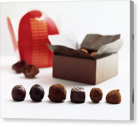 A Still Life Photo Of Gourmet Chocolates Canvas Print