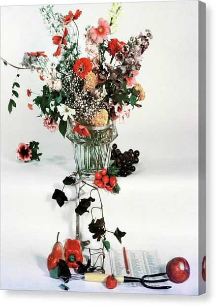 Vase Of Flowers Canvas Print - A Studio Shot Of A Vase Of Flowers And A Garden by Herbert Matter