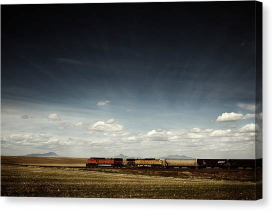 Freight Trains Canvas Print - A Train Rolls Across The American by Todd Korol
