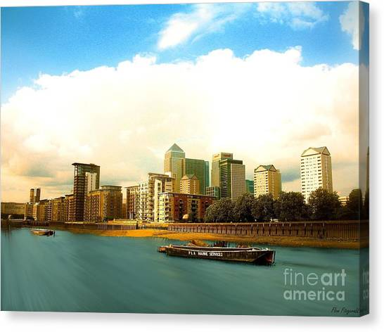 A View Over The River Thames Of Canary Wharf London Docklands England Canvas Print by Flow Fitzgerald