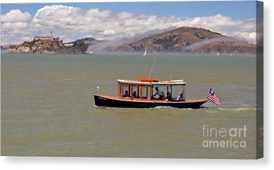 A Water Taxi Cruises Past Alcatraz Canvas Print by Jim Fitzpatrick