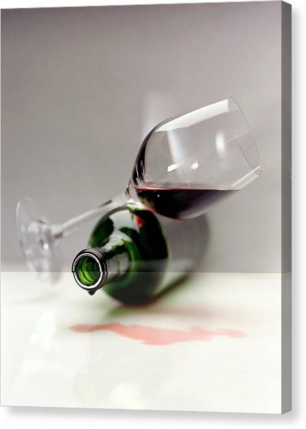 A Wine Bottle And A Glass Of Wine Canvas Print