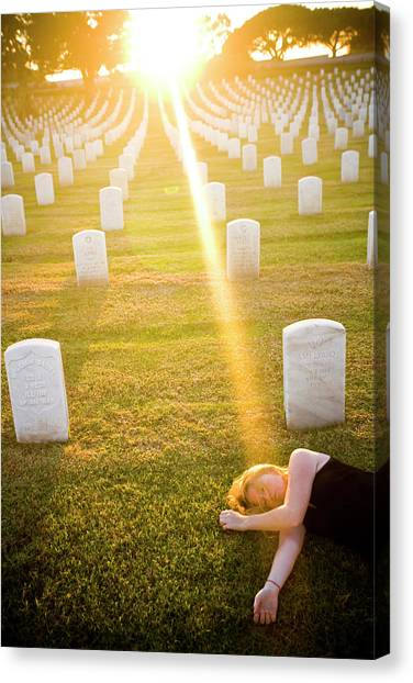 Fort Rosecrans National Cemetery Canvas Print - A Woman Lays On The Ground by Matt Mallams