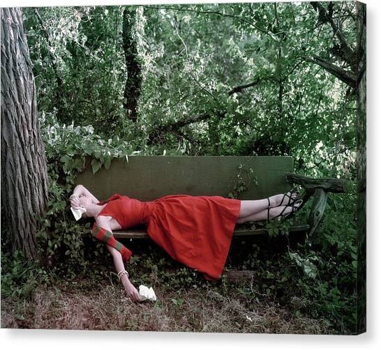 A Woman Lying On A Bench Canvas Print