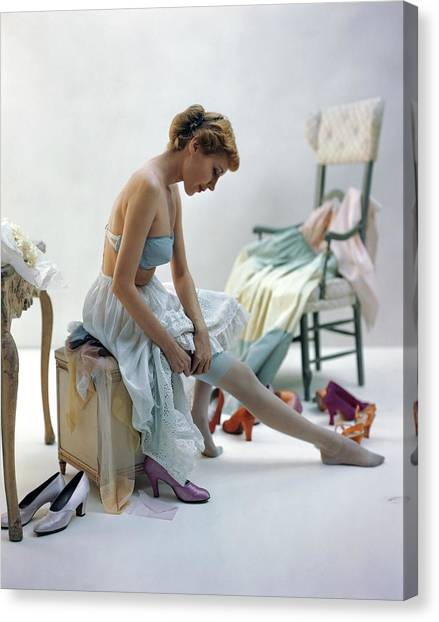 A Woman Putting On Her Stockings Canvas Print