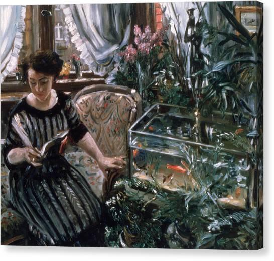 Goldfish Canvas Print - A Woman Reading Near A Goldfish Tank by Lovis Corinth