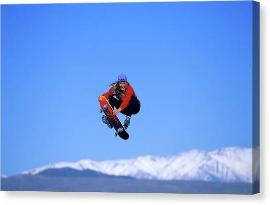 Trampoline Canvas Print - A Woman Skateboards While Jumping by Corey Rich