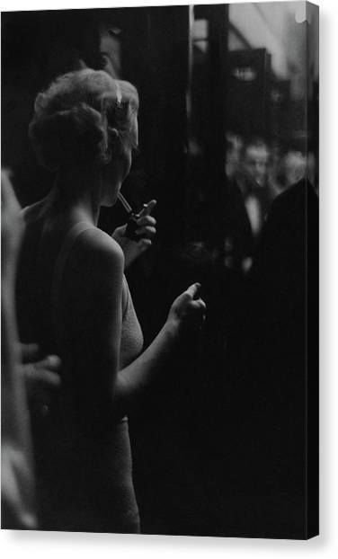 A Woman Smoking At The Music Box Canvas Print