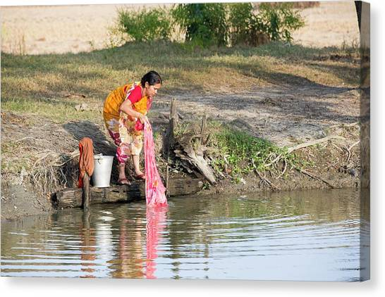 Ganges Canvas Print - A Woman Washing Clothes by Ashley Cooper
