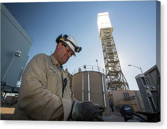 Hard Hat Canvas Print - A Worker At The Ivanpah Solar by Ashley Cooper