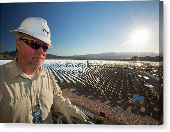 Clean Energy Canvas Print - A Worker At The Ivanpah Solar Thermal by Ashley Cooper