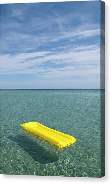 A Yellow Inflatable Raft Floating On Canvas Print