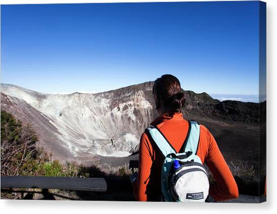 Vulcans Canvas Print - A Young Girl Looks At An Active Volcano by Michael Hanson