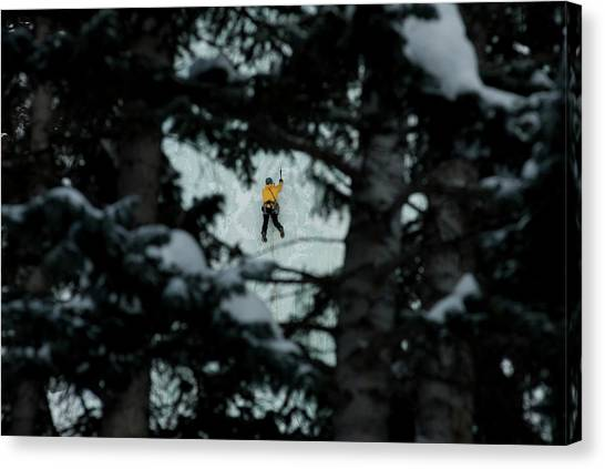 65c2a5c6b5 Ice Men Canvas Print - A Young Man Ice Climbing