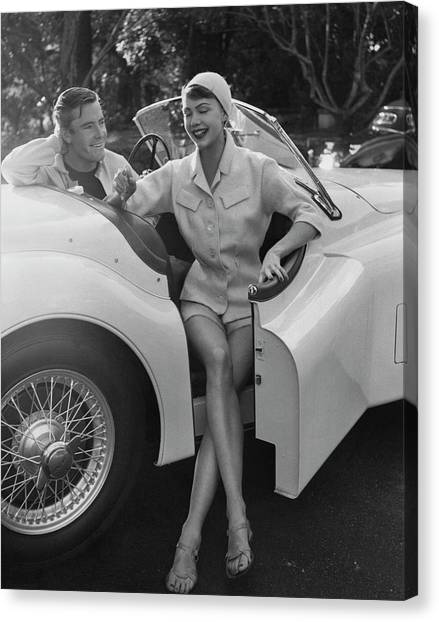 A Young Model Sitting In A Convertible Sports Car Canvas Print