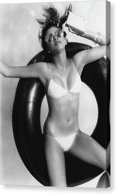 Inflatable Canvas Print - A Young Woman Floating On An Inner Tube by Albert Watson