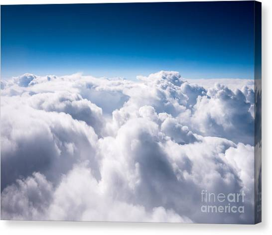 Aerial Canvas Print - Above The Clouds by Paul Velgos