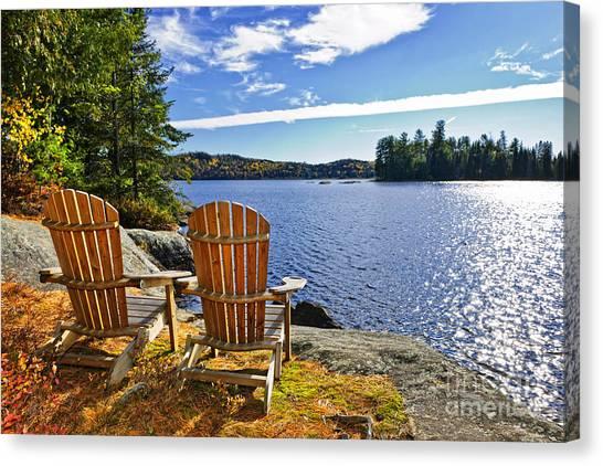Algonquin Park Canvas Print - Adirondack Chairs At Lake Shore by Elena Elisseeva