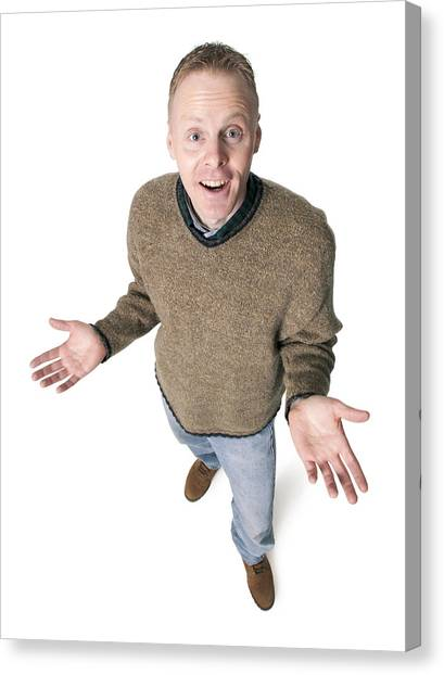 Adult Caucasian Man Dressed In Jeans And Green Sweater Gestures With His Hands Shrugs His Shoulders Canvas Print by Photodisc