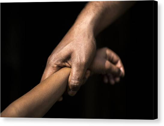 Adult Holding A Child's Wrist Canvas Print by James Morgan