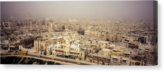 Syrian Canvas Print - Aerial View Of A City In A Sandstorm by Panoramic Images