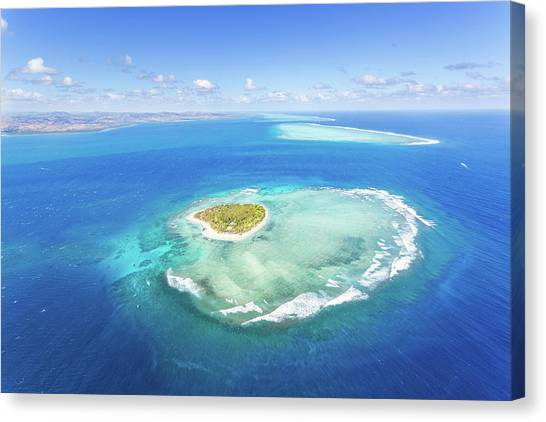 Aerial View Of Heart Shaped Island Canvas Print by Matteo Colombo