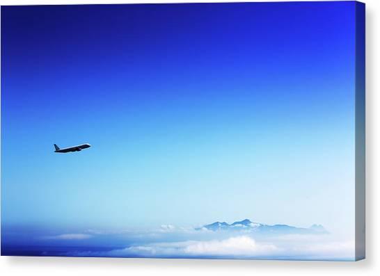 Aeroplane Flying In A Clear Blue Sky Canvas Print by Wladimir Bulgar