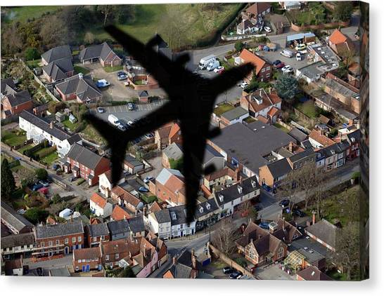 Aeroplane Shadow Over Houses Canvas Print by Victor De Schwanberg