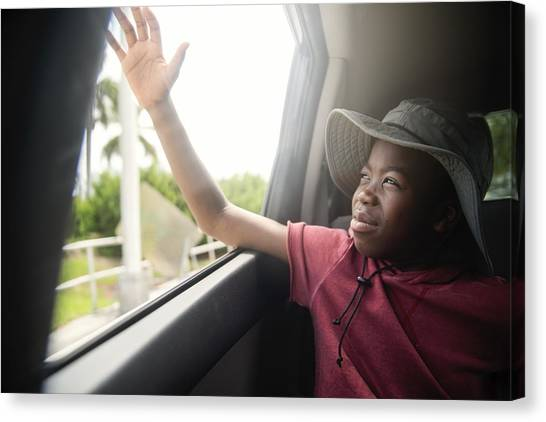 African-american Boy On The Back Seat Of A Car. Canvas Print by Martinedoucet