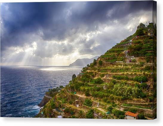 Afternoon Storm Clouds Over The Sea Canvas Print by Rick Starbuck