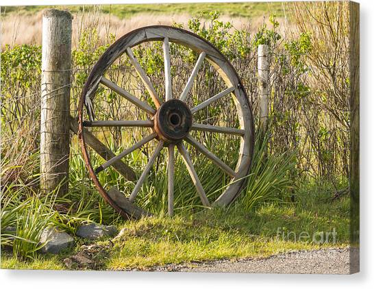 Outer Rim Canvas Print - Agriculture Cart Wheel Abandoned by Hugh McKean