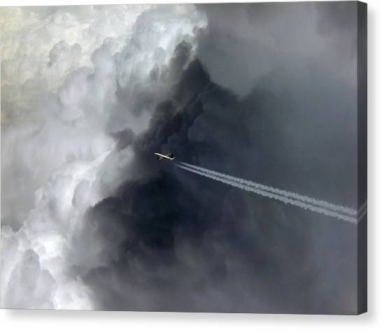 Thunderclouds Canvas Print - Airplane Flying Above Dark Clouds by Matthias Hauser