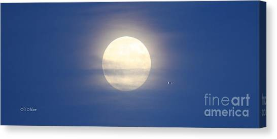 Airplane Flying Into Full Moon Canvas Print