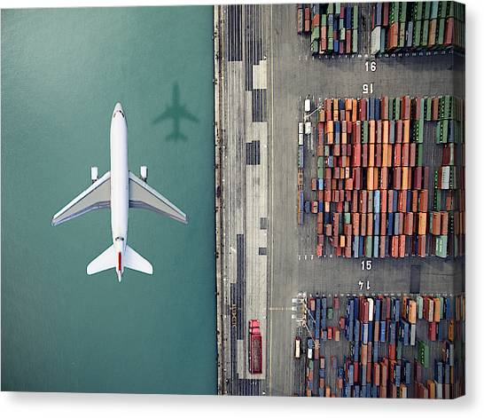 Airplane Flying Over Container Port Canvas Print by Orbon Alija