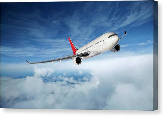 Airplane In Flight Canvas Print by Aaron Foster