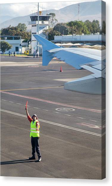 Oaxaca Canvas Print - Airport Worker Guides Jet Airliner by Jim West