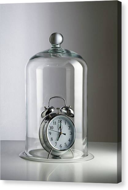 Alarm Clock Inside A Bell Jar Canvas Print by Science Photo Library