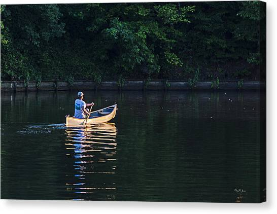 Alone On The Lake Canvas Print by Barry Jones