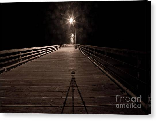 Alone On The Pier Canvas Print by Ronald Hoggard
